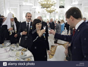 russian-president-dmitry-medvedev-r-toasts-french-singer-mireille-FMHJRX
